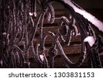 ornate metal forged gates in... | Shutterstock . vector #1303831153