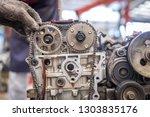 the mechanic opened the locking ... | Shutterstock . vector #1303835176