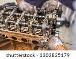 closeup repair of an opposing... | Shutterstock . vector #1303835179