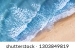 beach and waves from top view....   Shutterstock . vector #1303849819