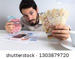 paper notes from canada. dollar.... | Shutterstock . vector #1303879720