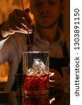 barmen making negroni alcohol... | Shutterstock . vector #1303891150
