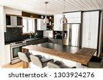 modern gray kitchen in a... | Shutterstock . vector #1303924276