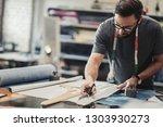 fashion designer working in his ... | Shutterstock . vector #1303930273