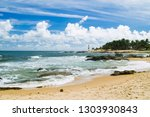 itapua lighthouse in salvador... | Shutterstock . vector #1303930843