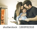 a father and a mother hugging... | Shutterstock . vector #1303932310