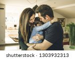 a father and a mother hugging... | Shutterstock . vector #1303932313