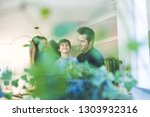a father and a mother hugging... | Shutterstock . vector #1303932316