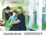 a father and a mother hugging... | Shutterstock . vector #1303932319