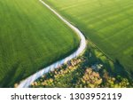 aerial view at the road and... | Shutterstock . vector #1303952119