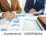 business executives consulting...   Shutterstock . vector #1303958656