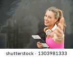 happy fitness instructor with... | Shutterstock . vector #1303981333