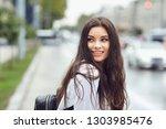beautiful happy brunette woman... | Shutterstock . vector #1303985476