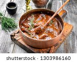 traditional german braised pork ... | Shutterstock . vector #1303986160