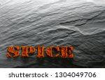 spice. ground paprika on a... | Shutterstock . vector #1304049706