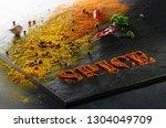 spice. turmeric  paprika  black ... | Shutterstock . vector #1304049709