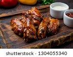 chicken wings in barbecue sauce | Shutterstock . vector #1304055340