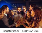 happy young drinking champagne... | Shutterstock . vector #1304064253