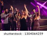 young people dancing in a...   Shutterstock . vector #1304064259