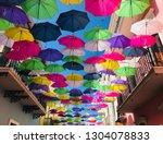Bright Umbrellas Handing Above...