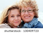 mother and daughter on a winter ... | Shutterstock . vector #130409723