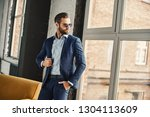 success concept. stylish young... | Shutterstock . vector #1304113609