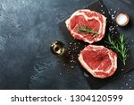 fresh meat on slate black board ... | Shutterstock . vector #1304120599