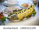 stuffed pike decorated with... | Shutterstock . vector #1304121109