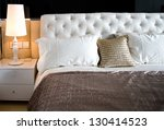 Stock photo king sized bed in a business hotel room 130414523