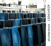 row of hanged jeans in a shop | Shutterstock . vector #130414529