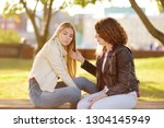 young woman support and soothe... | Shutterstock . vector #1304145949