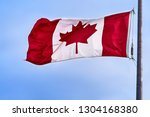 canadian flag flying in light... | Shutterstock . vector #1304168380