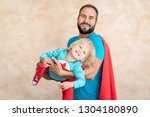man and child super hero at... | Shutterstock . vector #1304180890