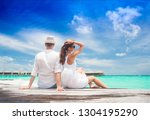 happy young couple in white... | Shutterstock . vector #1304195290