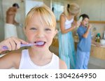family wearing pajamas brushing ... | Shutterstock . vector #1304264950