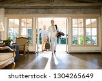 two mature men in hotel foyer... | Shutterstock . vector #1304265649
