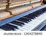 open piano keys close up.... | Shutterstock . vector #1304278840