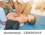 cpr aid dummy medical training... | Shutterstock . vector #1304342419