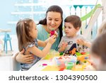 teacher with kids working with... | Shutterstock . vector #1304390500