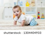 funny baby boy crawling on... | Shutterstock . vector #1304404933