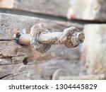rusty metal bolt and nut | Shutterstock . vector #1304445829