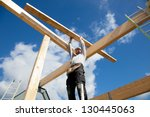 real builder building a roof... | Shutterstock . vector #130445063
