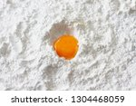 egg yolk on flour   Shutterstock . vector #1304468059