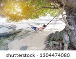 young man lying on the beach... | Shutterstock . vector #1304474080