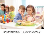 group of kids play in... | Shutterstock . vector #1304490919