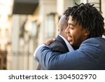 father hugging his adult son.   Shutterstock . vector #1304502970