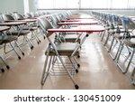 Empty classroom with many...