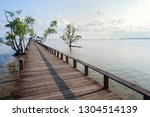 wooden bridge on the beach into ... | Shutterstock . vector #1304514139