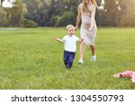 mother with a child plays in... | Shutterstock . vector #1304550793