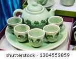 green ceramic kitchenware in... | Shutterstock . vector #1304553859
